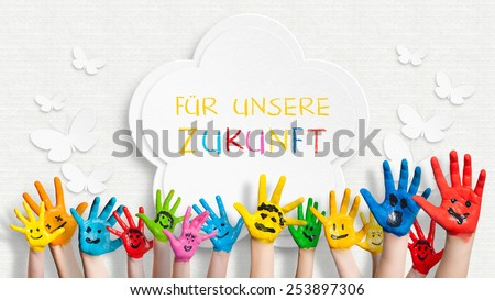 colorful painted hands in front of a decorated wall with the sentence