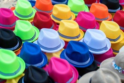 Colorful Panama hats for sale from a sidewalk vendor