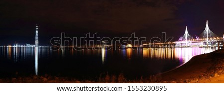 colorful panoram night cityscape with illuminated bridge over river