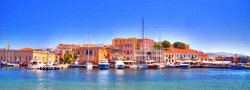 Colorful panoramic HDR image of the shore and skyline of Chania city from its port - Old Venetian Harbour on clear blue sky, Crete, Greece
