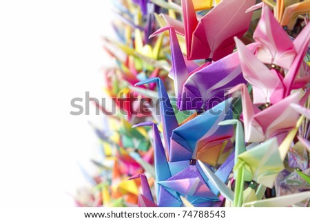 Colorful paper birds hanging together using fishing lines. Shallow depth of field.