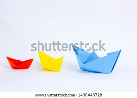 Colorful paper color. Ship shape of origami.  Easy origami shape to build. Origami with white background. Different size of ship shape. #1430448728