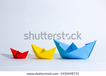 Colorful paper color. Ship shape of origami.  Easy origami shape to build. Origami with white background. Different size of ship shape. #1430448731