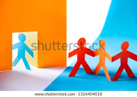 Colorful paper cut figures - group of people at the door, welcome or unwanted. Symbolism to migration. #1326404018