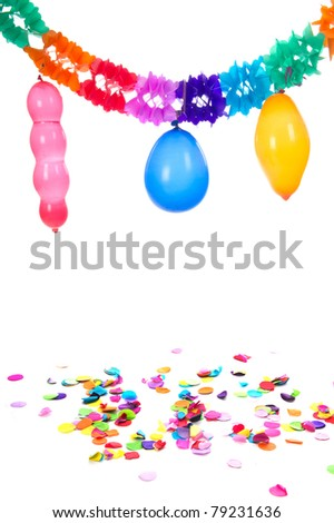 Colorful paper party guirlandes and confetti with balloons on white background