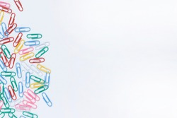colorful paperclips on a white background.