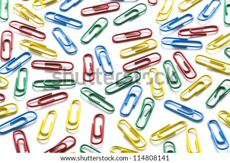 colorful paperclips on white background