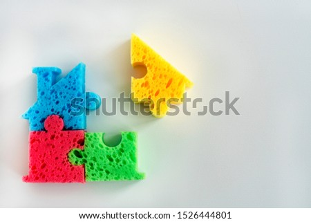 Photo of  colorful parts on a light background. Creation and design  building. Concept component parts of something, Creating something. Concept The missing part. Completion of construction.