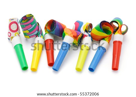 Colorful party blowers arranged in a row on white