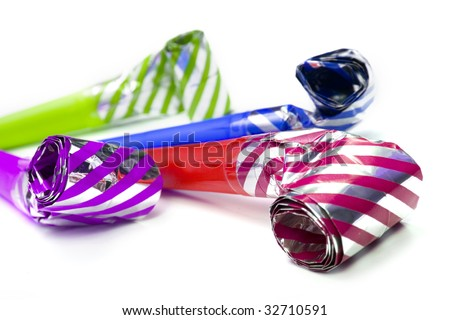 Colorful party blowers isolated on white background