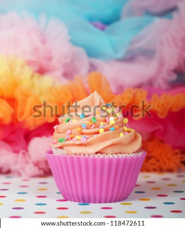 colorful party cupcake with confetti sprinkles