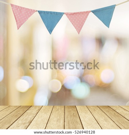 Colorful party flags hanging on blur bokeh and perspective wood background with copy space for text, new year and festival card, banner #526940128