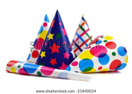 Colorful party hats and noisemakers on a white background