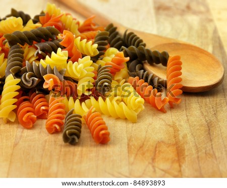 Colorful pasta on a cutting board, close up