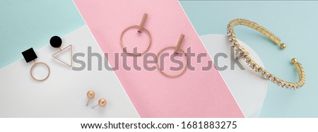 Colorful pastel colors collage of modern golden jewelries bracelet and earrings  Foto stock ©