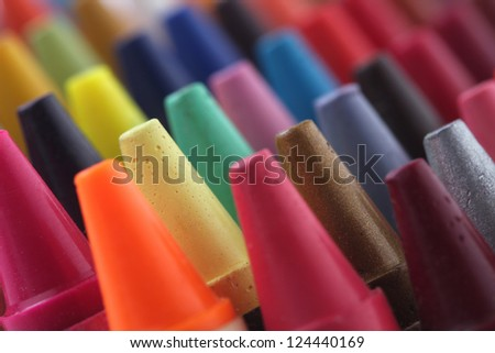 Colorful pastel(crayon) pencils tips for children and others used for kids drawing & coloring arranged attractively in rows and columns making a stunning display of colors
