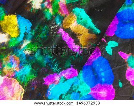Colorful patchwork. Modern style. Abstract dynamic background. Dynamic artistic splashes. Brushstrokes on painting fond. Blue image. Tie dye. Dirty art. Black pattern.