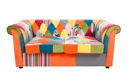 Colorful patchwork sofa isolated on white background