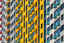 Colorful pattern from windows and balconies in modern residential building