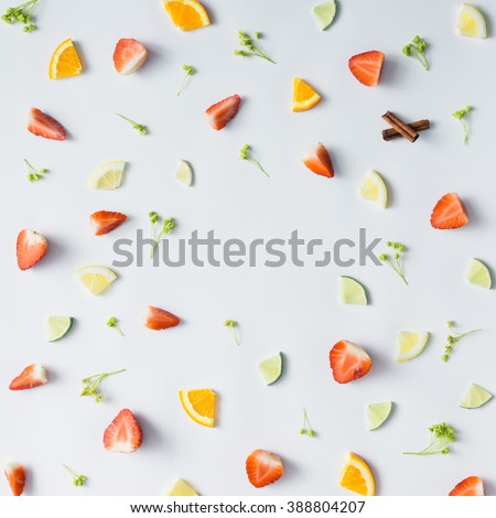 Colorful pattern made of citrus fruits, leaves and strawberries.