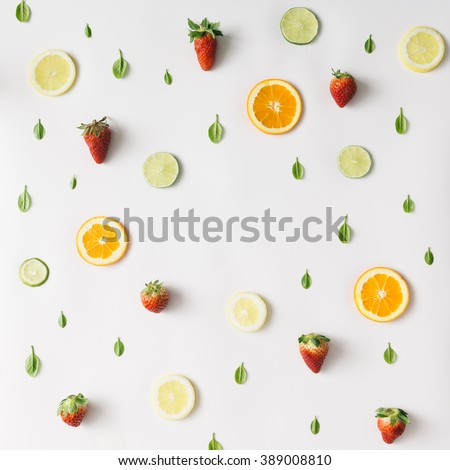 Colorful pattern made of citrus fruits, leaves and strawberries - Shutterstock ID 389008810