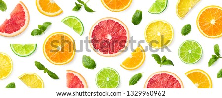 Colorful pattern of citrus fruit slices and mint leaves isolated on white background. Top view, flat lay Сток-фото ©