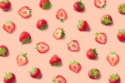 Colorful pattern of strawberries on pink background. Top view