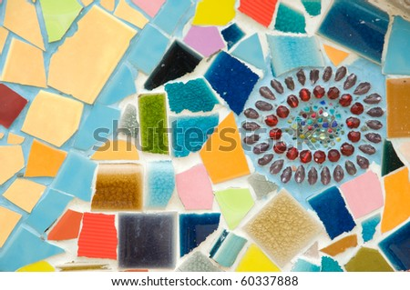 colorful pattern of the wall made from broken tile and crystal