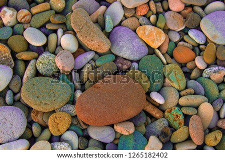 Colorful pebbles top view. Colorful pebbles. Colorful pebbles background. Colorful pebbles view #1265182402