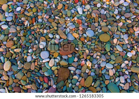 Colorful pebbles top view. Colorful pebbles. Colorful pebbles background. Colorful pebbles view #1265183305
