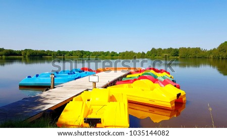 Colorful pedal boats on the boat dock at sea #1035144082