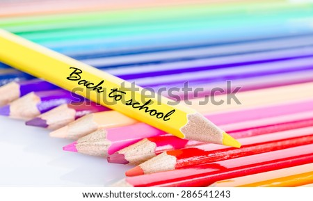 Colorful pencil crayons on a white background, Back to school.