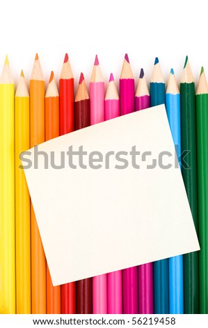 Colorful pencil crayons with note on a white background, Education message