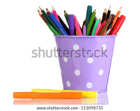 Colorful pencils and felt-tip pens in purple pail isolated on white