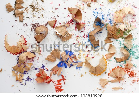 Colorful pencils crayons shavings after sharpening concept background