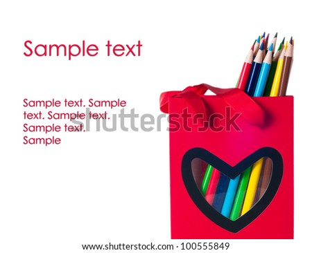 colorful pencils in a red bag with heart shape isolated on white background - stock photo