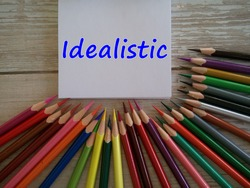 colorful pencils on the table with word idealistic