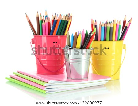 Colorful pencils with copybooks isolated on white