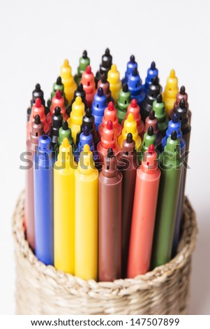 colorful pens in a box on a light background