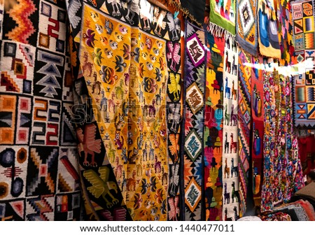 Colorful Peruvian artisanal textiles cloth with inca and traditional patterns at street Andean market in Pisac, sacred valley, Peru.