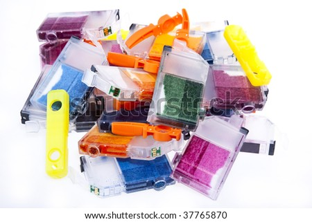 Colorful pile of inkjet printer ink cartridges empty and ready for recycling.
