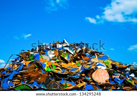 Colorful pile of metal waste on a recycling plant