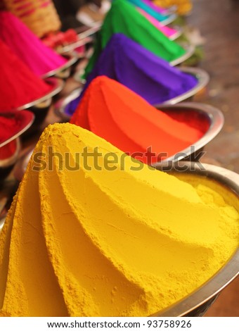 Colorful piles of powdered dyes used for holi festival on display in an indian shop at mysore