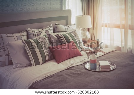 colorful pillows on white bed...