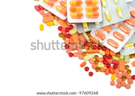 colorful pills and blisters on a white background