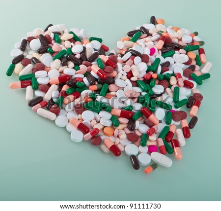colorful pills in a shape of heart