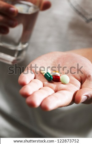Colorful pills in hand