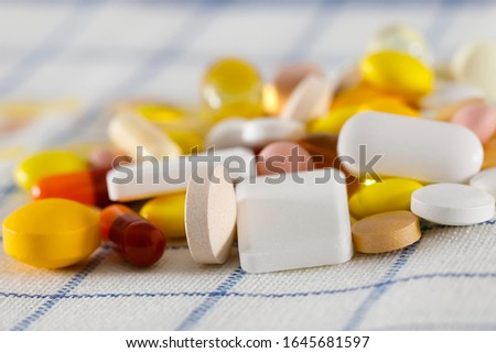 Colorful pills on a napkin. These varied tablets have various shapes and various colors.