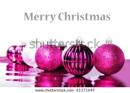 Colorful pink christmas baubles with space for text