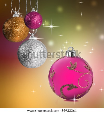 Colorful pink gold and  silver christmas baubles balls with colorful background
